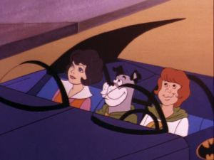 Wendy, Wonderdog, and Marvin sit in the Batmobile