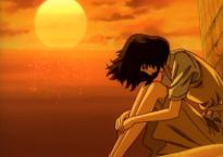 Nanako sits on the beach