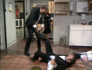 "John Cleese as Basil Fawlty and Andrew Sachs as Manuel in Fawlty Towers, ""Gourmet Night."""
