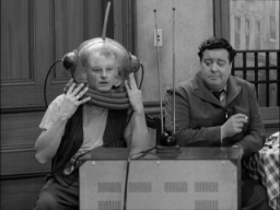 Ralph and Ed watch television on The Honeymooners