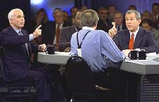 John McCain and George W. Bush during a debate with Larry King moderating