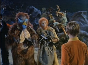Wally Cox as Tiabo, Janos Prohaska as Monster, Lost in Space