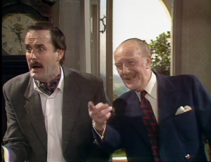 "John Cleese as Basil Fawlty and Ballard Berkely as Major Gowan, Fawlty Towers, ""Communication Problems"""