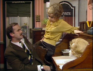 "John Cleese as Basil Fawlty and Prunella Scales as Sybil Fawlty, Fawlty Towers, ""Communication Problems"""