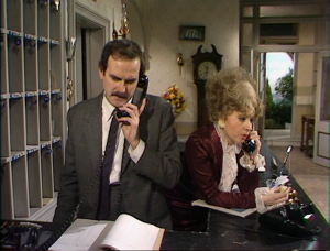 "John Cleese as Basil Fawlty and Prunella Scales as Sybil Fawlty, Fawlty Towers, ""The Psychiatrist"""