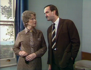 "Joan Sanderson as Mrs. Richards and John Cleese as Basil Fawlty, Fawlty Towers, ""Communication Problems"""