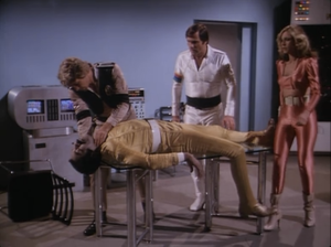 "Christopher Stone as Commander Royko, Erin Grey as Wilma Deering and Gil Gerard as Buck Rogers, Buck Rogers in the 25th Century, ""Space Vampire"""
