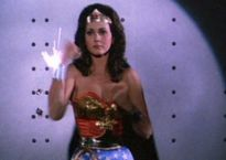 Wonder Woman deflects bullets with her bracelets