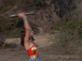 Wonder Woman catches a rocket...with her bare hands. LIKE A BOSS.
