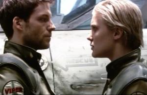 "Jamie Bamber as Lee ""Apollo"" Adama and Katee Sackhoff as Kara ""Starbuck"" Thrace, Battlestar Galactica, ""33"""
