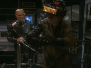 "Robert Llewellyn as Kryten and Craig Charles as Dave Lister, Red Dwarf, ""Gunmen of the Apocalypse"""