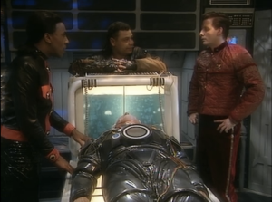 "Robert Llewellyn as Kryten, Chris Barrie as Arnold Judas Rimmer, Danny John-Jules as Cat and Craig Charles as Dave Lister, Red Dwarf, ""Gunmen of the Apocalypse"""