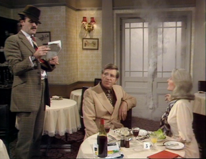 "John Cleese as Basil Fawlty, Claire Nielson as Mrs. Hamilton and Bruce Boa as Mr. Hamilton, Fawlty Towers, ""Waldorf Salad"""