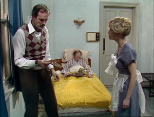 "John Cleese as Basil Fawlty, Derek Royle as Mr. Leeman and Connie Booth as Polly Sherman, Fawlty Towers, ""The Kipper And The Corpse"""