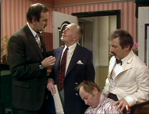 "John Cleese as Basil Fawlty, Ballard Berkeley as Major Gowan, Derek Royle as Mr. Leeman and Andrew Sachs as Manuel, Fawlty Towers, ""The Kipper And The Corpse"""
