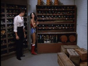 Wonder Woman prepares to unnecessarily destroy so much wine.