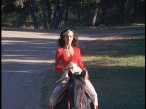 Wonder Woman rides a horse