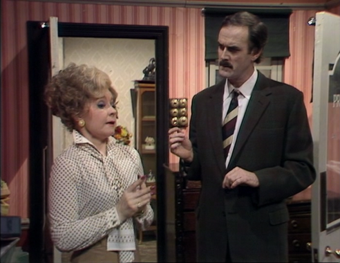"Prunella Scales as Sybil Fawlty and John Cleese as Basil Fawlty, Fawlty Towers, ""The Anniversary"""