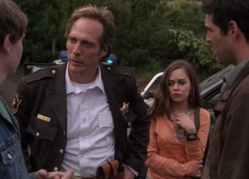 """William Fitchner as Sheriff Tom Underlay and Alexis Dziena as Kira, Invasion, """"Pilot"""""""