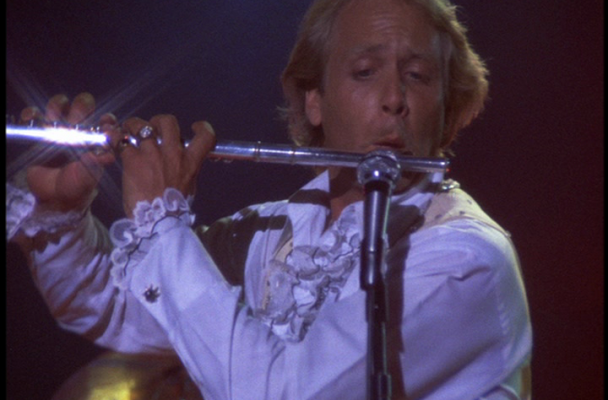 Hamlin plays the flute during a concert