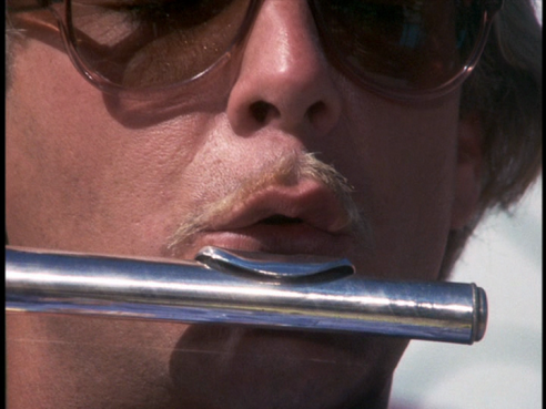 A close-up on Hamlin's lips and flute