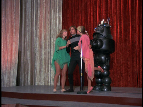 Three Logies on stage with Robby the Robot